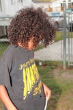 Young boy upset. African american boy upset long hair Stock Photo