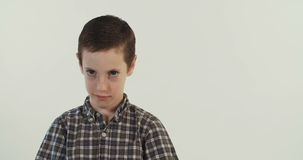 Young boy upset and mad. On a white studio background stock footage