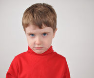 Young Boy Upset with Red Shirt Royalty Free Stock Photo