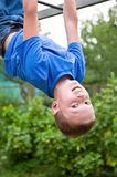 Young boy upside down doing gymnastics Royalty Free Stock Image