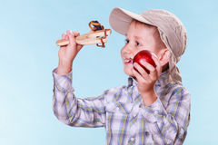 Young boy use sling shot hold apple. Royalty Free Stock Photos