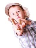 Young boy use sling shot shoot mandarine. Royalty Free Stock Photo