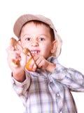 Young boy use sling shot shoot mandarine. Royalty Free Stock Photography