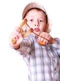 Young boy use sling shot shoot mandarine. Royalty Free Stock Image