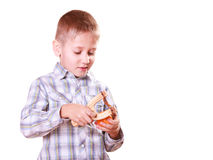 Young boy use sling shot shoot mandarine. Stock Image