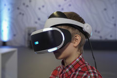 Young boy uses VR-headset display Royalty Free Stock Photo