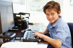 Young boy using computer at home Stock Photo