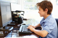 Young boy using computer at home Royalty Free Stock Photos