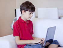 Young Boy is Using Computer Stock Image