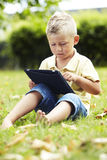 Young boy using digital tablet Stock Photos