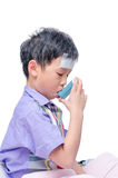 Young boy using inhaler Stock Photo