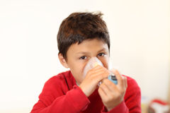 Young boy using inhaler Stock Photos