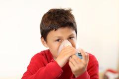 Young boy using inhaler Stock Photos