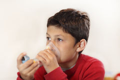 Young boy using inhaler Stock Photography