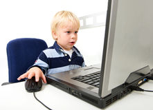 Young Boy Using Laptop Royalty Free Stock Photos