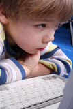Young boy using a laptop Stock Photography