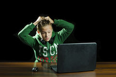 Young boy using a laptop computer Stock Image