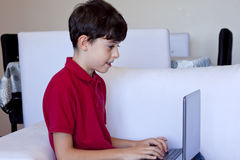 Young Boy Using Laptop Computer Royalty Free Stock Photo