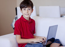 Young Boy Using Laptop Computer Stock Images