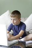 Young boy using a laptop Royalty Free Stock Images