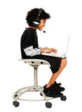 Young Boy Using Laptop and Headset Royalty Free Stock Photos
