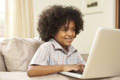 Young Boy Using Laptop At Home Royalty Free Stock Photography