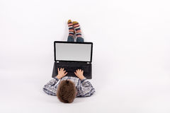 Young boy using laptop Royalty Free Stock Photography