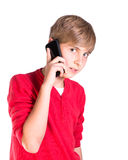 Young boy using mobile cell phone. Pre teen caucasian boy making call on mobile telephone stock photo