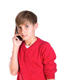 Young boy using mobile cell phone. Pre teen caucasian boy making call on mobile telephone royalty free stock photos