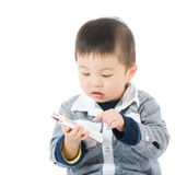 Young boy using mobile Stock Photography