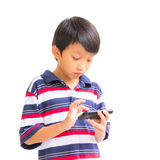 Young boy using mobile phone Royalty Free Stock Images