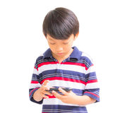 Young boy using mobile phone Stock Photos