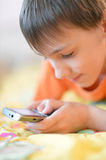Young boy using mobile phone Stock Photography