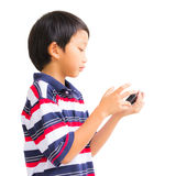 Young boy using mobile phone Royalty Free Stock Photography