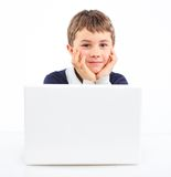 Young boy using notebook computer Stock Images