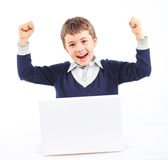 Young boy using notebook computer Stock Photos