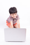 Young boy using notebook Stock Images
