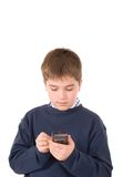 Young boy using a pda Stock Images