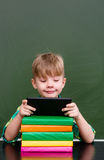 Young boy using tablet computer in classroom Royalty Free Stock Photos