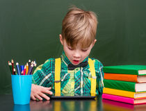 Young boy using tablet computer in classroom Royalty Free Stock Photography