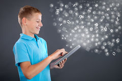 Young boy using tablet,school learning or technology concept Stock Photo