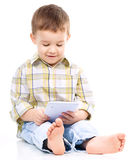 Young boy is using tablet Stock Photography