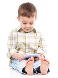 Young boy is using tablet Stock Images