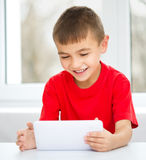 Young boy is using tablet Royalty Free Stock Images