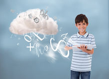 Young boy using tablet to connect to cloud computing Stock Image
