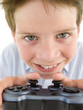 Young boy using videogame. Controller smiling Stock Image