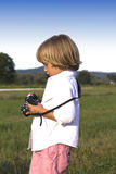 Young boy with vintage photo camera Royalty Free Stock Image