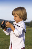 Young boy with vintage photo camera Royalty Free Stock Photography