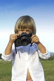 Young boy with vintage photo camera Royalty Free Stock Photos