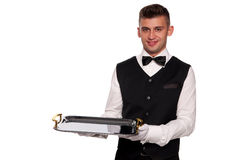 A young boy waiter with a tray Royalty Free Stock Photo